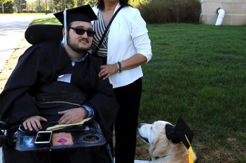 Dominic Wolff, the grandson of Mary and the late Dan Wiebelhaus, Fordyce, was one of the students going through Commencement ceremonies Saturday at Wayne State College.  Dominic picked up his Master's Degree in Clinical Mental Health Counseling. His service dog, Summer, was all dressed up for the occasion, as well. Dominic's parents are Tom and Francine Wolff. Norfolk. Francine is a 1982 graduate of Cedar Catholic High School.