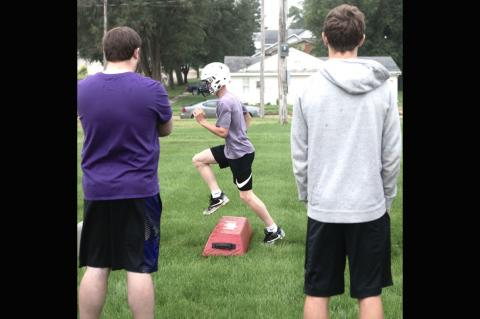 Hartington-Newcastle's Shaye Morten runs a drill during the first practice of the season in Hartington Monday. The Wildcats will move down to Class D2 this season and will have a bit of a target on their backs as they have been rated in the Top 10 in the preseason Huskerland Report football poll.