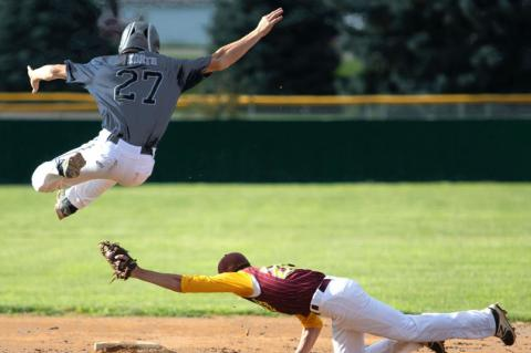Hartington's Turner Korth hurdles over Neligh's Cole Belitz during a Sr. Legion game against Neligh Friday.