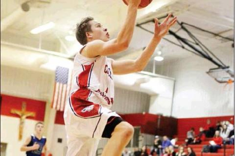 Cedar Catholic's Brady Steffen goes up for a layup during Friday night action here against MidStates Conference foe O'Neill. The Trojans won the contest to move to 2-0 on the season.