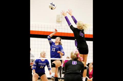 Hartington-Newcastle's Belle Harms goes up for a block during action Thursday at Laurel.