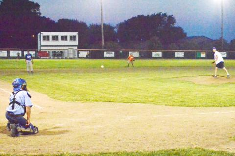 Jay Heimes pitches to his dad, Alton Heimes, during the Old Timers game Saturday night in Wynot.