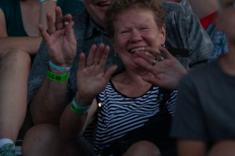 Timo and Mirja Havulinna of Finland enjoy to Scotty McCreery concert during the Cedar County Fair in Hartington, Neb., on Friday, July 20, 2018. Photo by Elsie Stormberg