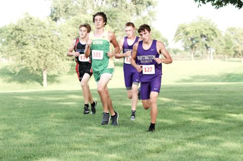 Hartington-Newcastle's Dagen Joachimsen (127) runs in a group of runners that includes Brayden Kathol (over Joachimsen's shoulder) in the final 1,000-meter stretch at Thursday's Wisner-Pilger Invitational. The Wildcat boys edged BRLD by six points to claim the title.