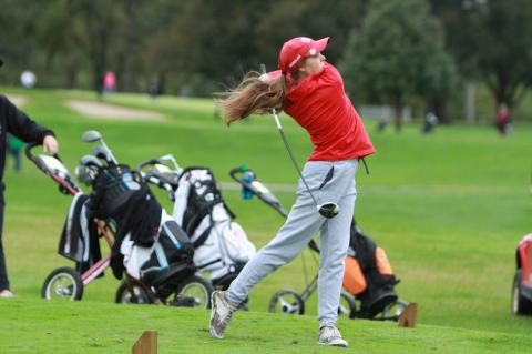 Cedar Catholic junior Rebekah Kleinschmit tees off