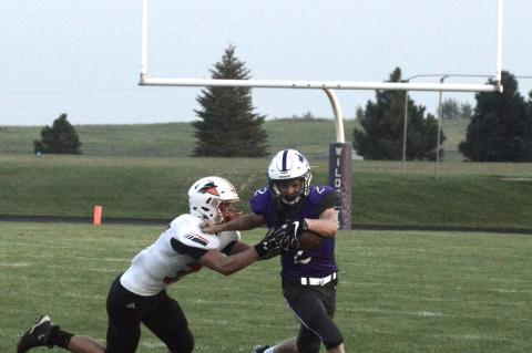 Shaye Morten stiff arms a CWCE defender during opening night action.