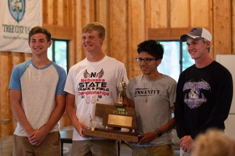 Lincoln McPhillips, Cole Schmidt, Brian Santiago and Turner Korth hold the Class C State Track trophy during a reception at the Felber Park Shelter House in Hartington, Neb., on Wednesday, May 23, 2018.