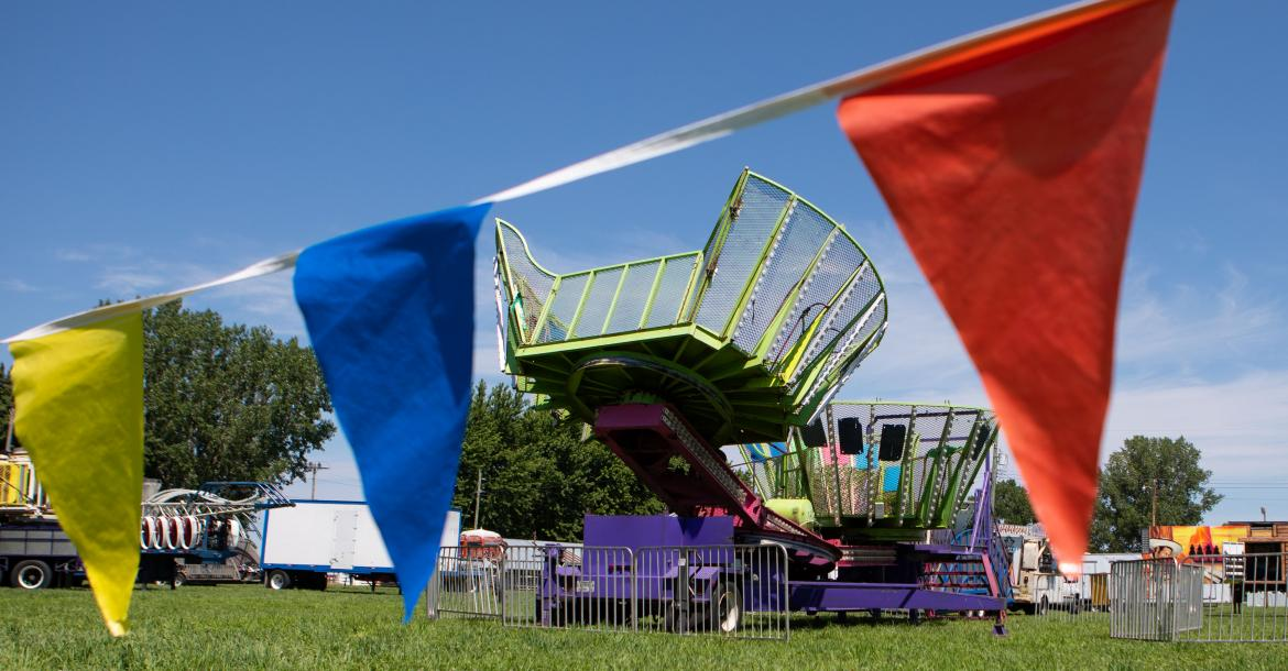 Carnival rides sit at the Cedar County fair grounds in Hartington, Neb., on Monday, July 16, 2018.
