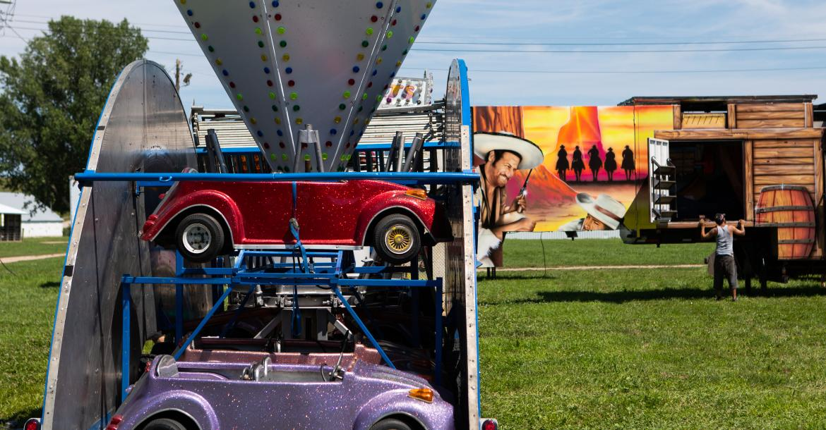 Carnival rides wait to be unloaded at the Cedar County fair grounds