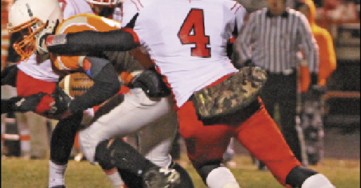 Cedar Catholic's Alex Fischer forced a turnover on downs with a sack on Oakland-Craig quarterback Cole Mitchell to preserve a 19-0 shutout for the Trojans in the 2014 semifinals.