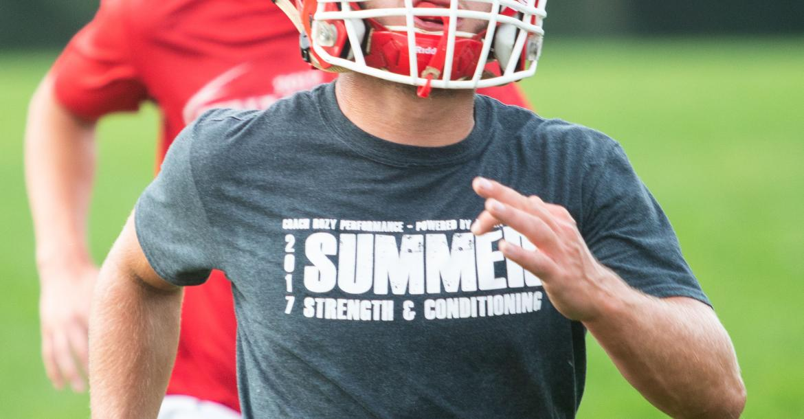 Cedar Catholic's Eric Hoesing sprints during a drill at the first practice of the season. Photo by Elsie Stormberg