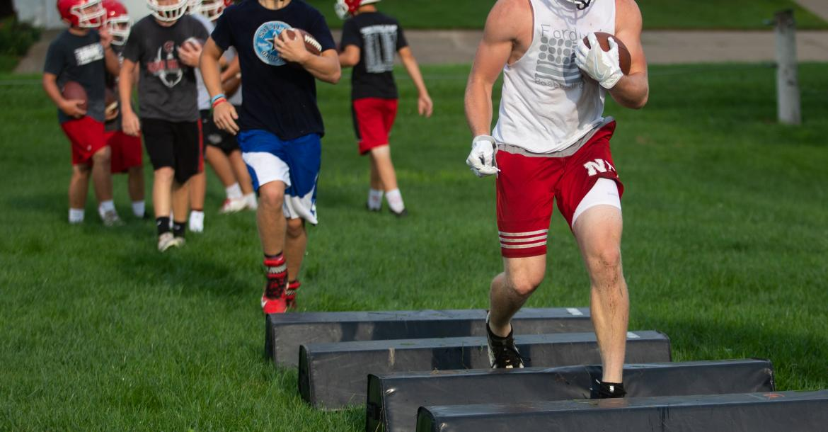 Cedar Catholic's Jake Kaiser leads a drill during the first practice of the school year. Photo by Elsie Stormberg