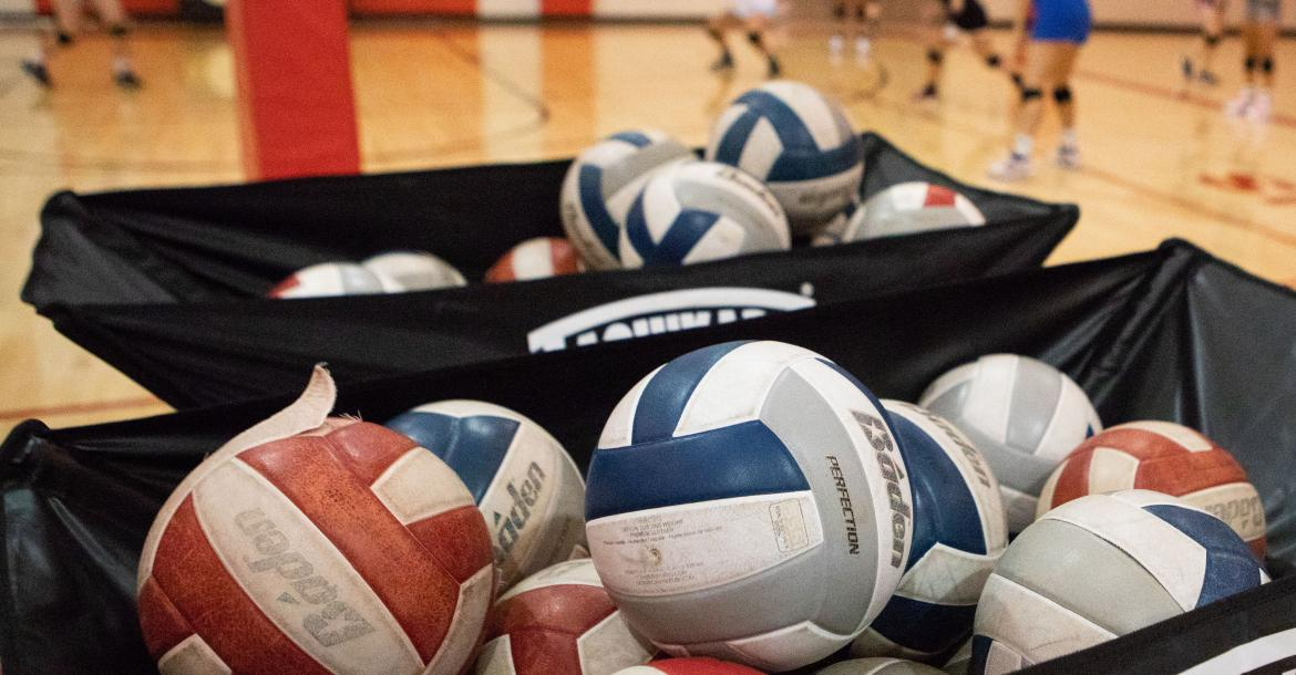 The Cedar Catholic volleyball team runs a drill during the second practice of the season. Photo by Elsie Stormberg