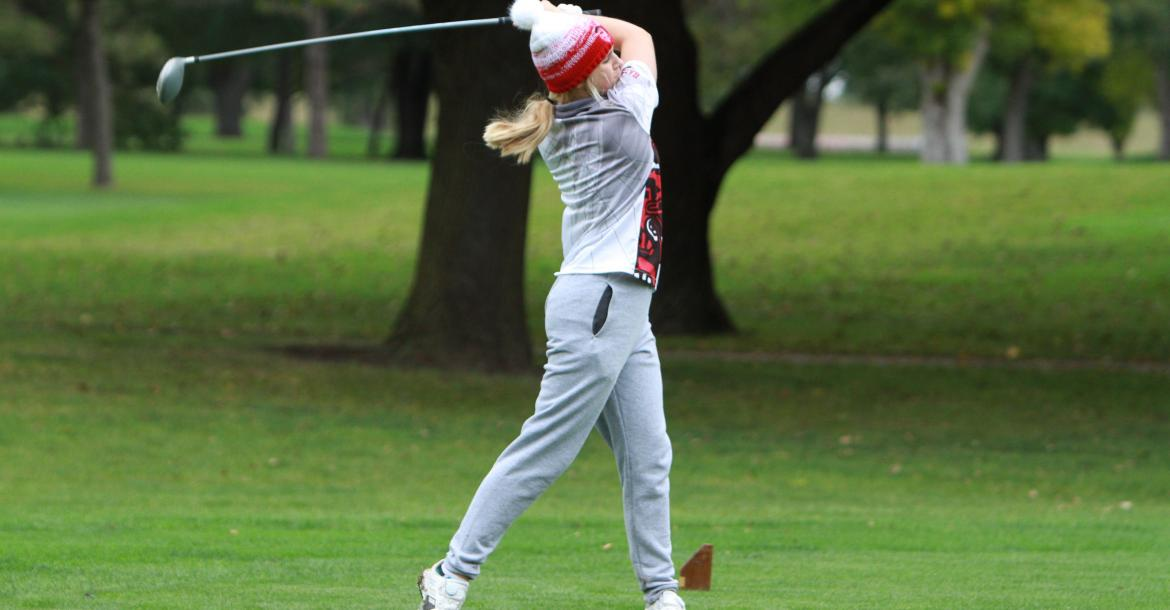 Cedar Catholic freshman Hallie Noecker tees off