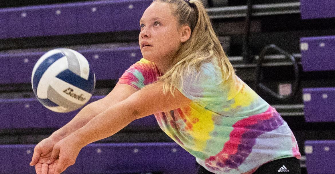 Hartington-Newcastle's Erin Folkers passes the ball during a drill at the second practice of the season. Photo by Elsie Stormberg