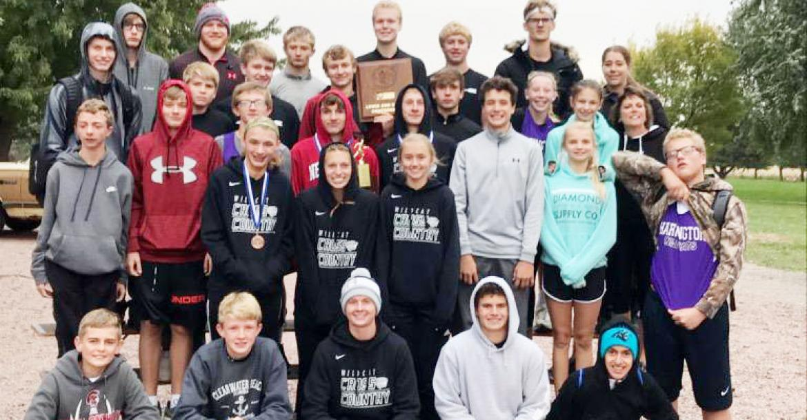 The Hartington-Newcastle cross country teams wound up the regular season Friday at the Lewis and Clark Conference meet at Rolling Hills Golf Course, Wausa. Team members are: (top row) Parker Albers, Matthew Meisenheimer, Zach Burcham, Mack Kuehn, Carson Becker, Sam Harms, Coach Mandy Hochstein,(second row from top) Jaxson Bernecker, Bennet Sievers, Calvin Christensen, Chase Lammers, Cole Noecker, Laney Kathol, Kylie Clinebell, Coach Laura Noecker, (second row from bottom) Lukas Wortmann, Shay Dickes, Jude K