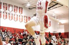 Patented dunks like this helped Cedar Catholic's Matthew Becker finish his high school career third on Cedar Catholic's all-time scoring list. He signed a letter of intent last week to take his basketball talents to Mt. Marty College in Yankton.