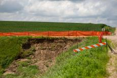 Barricades are up at the intersection of Road 881 and Avenue 575 in Hartington, Neb., on Sunday, July 15, 2018.