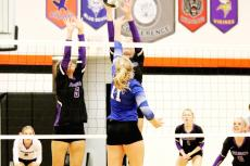Hailey Gottsche and Belle Harms stick together to keep the ball from getting through their block.