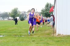 Hartington-Newcastle cross country runners Riley Kuehn and Dagen Joachimsen race around the corner at the beginning of last week's Lewis and Clark Conference race at Rolling Hills Golf Course in Wausa