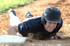 Seth Wiebelhaus slides back to first base during a Sr. Legion game in Neligh