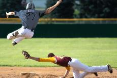 Turner Korth hurdles over a page from Neligh's Cole Belitz during a Sr. Legion game