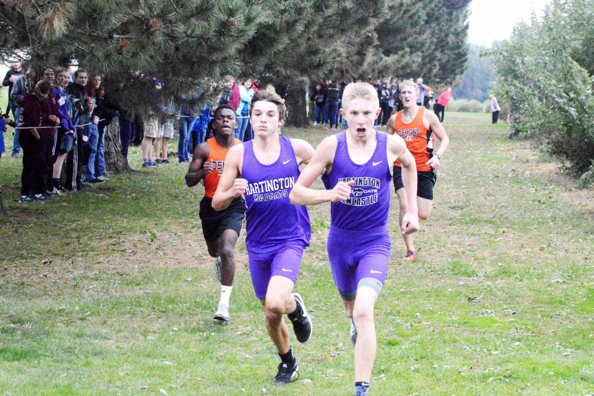 Hartington-Newcastle's Brayden Kathol and Dagen Joachimsen edge out Osmond's Johnson Chishiba and Jared Bessmer for first and second place at the close of Friday's Lewis and Clark Conference meet