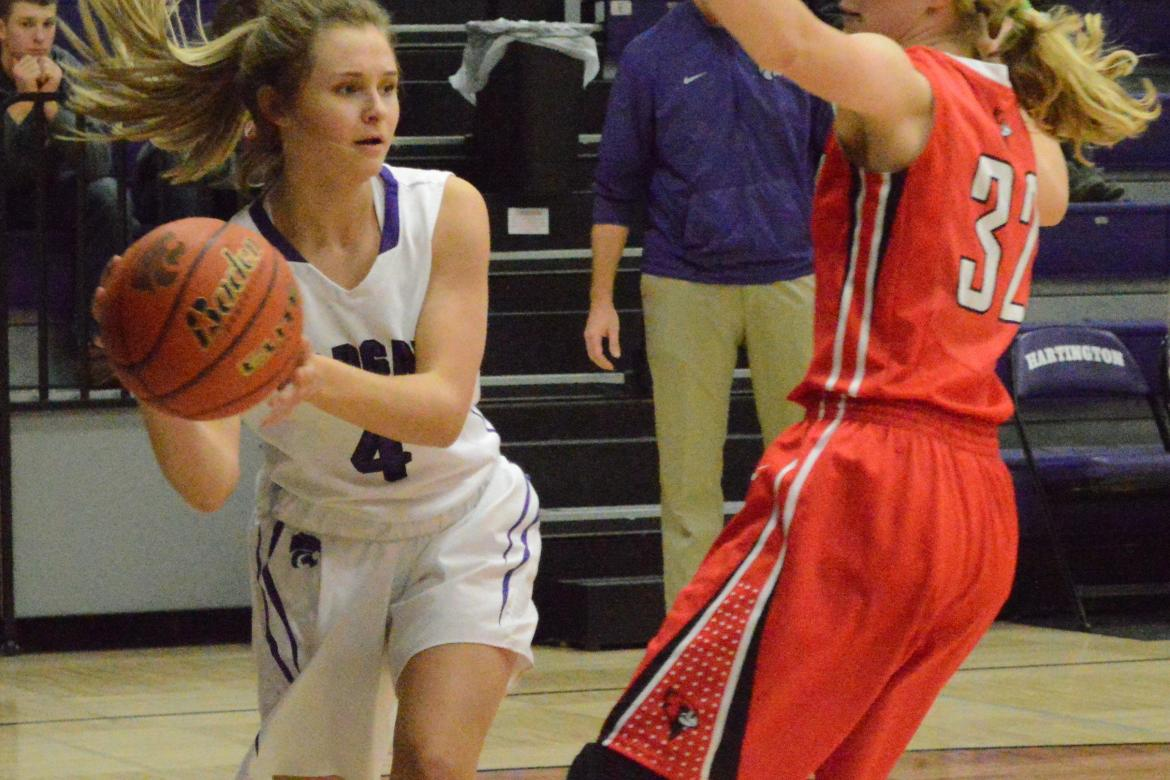 HNS senior Hailey Gottsche looks for a pass along the baseline in Friday's win against Randolph.